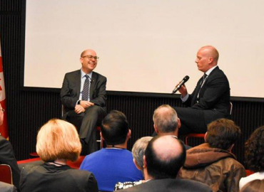 Alán Aspuru-Guzik (left) talks with Ted Sargent, U of T's vice president international (right), at an event in Mexico City
